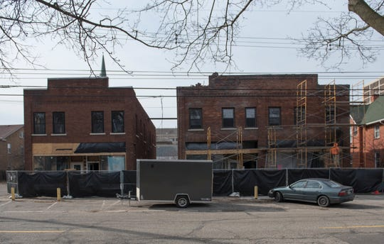 Construction takes place at 515 W. Ionia in downtown Lansing, Tuesday, April 2, 2019.