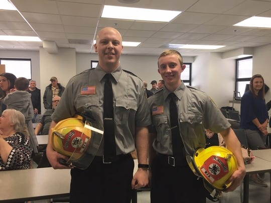 Garrett Prise, left, and Benjamin Raudebaugh were sworn in Tuesday as new firefighters/EMTs at the Mansfield Fire Department.