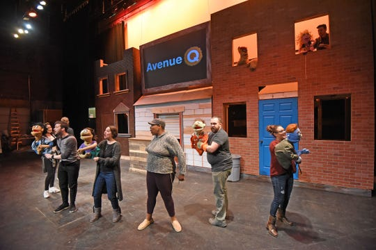 The cast of Avenue Q rehearse a musical number with their puppets Monday evening during their dress rehearsal at the Renaissance Theatre.