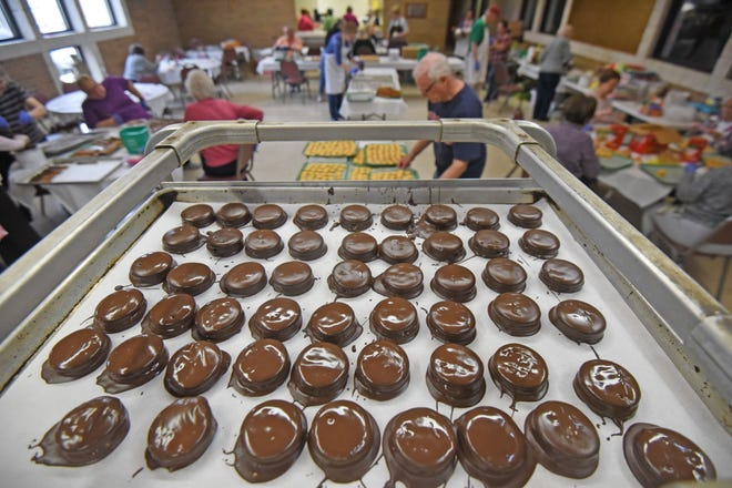 Chocolate covered crackers fill racks as workers create confectionery delights Tuesday morning at the St. Peter's Franciscan Center. The candy will be for sale on April 16 -17 in the basement of St. Peter's Catholic Church.
