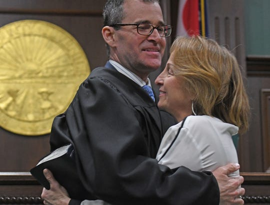 Steve McKinley hugs his wife Ann on Tuesday after we was sworn in as Richland County juvenile court judge.