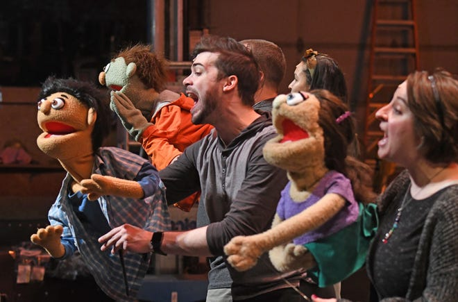 The cast of Avenue Q rehearse a number Monday evening at the Renaissance Theatre.
