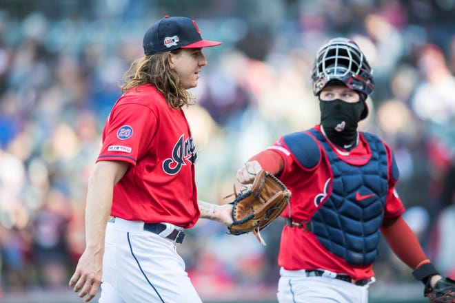 Cleveland Indians starter Mike Clevinger, with catcher Roberto Perez, was a victim of his own inept offense in the Tribe's home opener, getting no decision despite pitching shutout, one-hit ball for seven innings with a career-high 12 strikeouts.