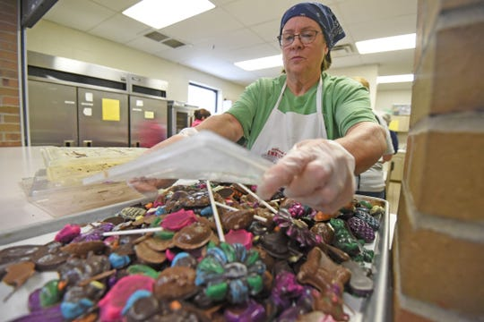 Carol Latchuk piles molded Easter candy on a tray before packaging on Tuesday morning at St. Peter's Franciscan Center.