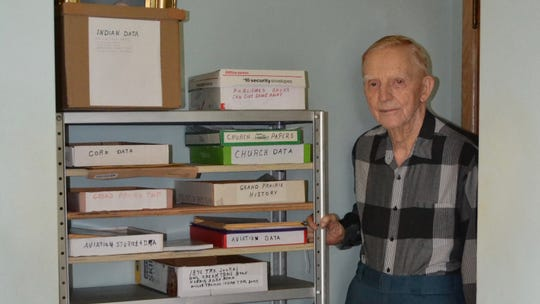 Kensel Clutter, a Marion resident passionate about local history, stands next to some of the data he's collected over the years.