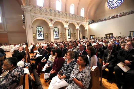 Parishioners watch as Bishop David Talley is installed in Memphis at the Cathedral of the Immaculate Conception on Tuesday, April 2, 2019.