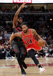 Chicago Bulls guard/forward Wayne Selden Jr., right, drives as Portland Trail Blazers forward Maurice Harkless defends during the first half of an NBA basketball game Wednesday, March 27, 2019, in Chicago. (AP Photo/Nam Y. Huh)
