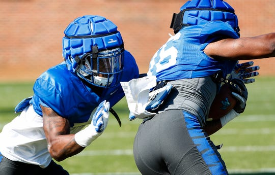 Memphis' Josh Perry (left) has moved from safety to a linebacker role.