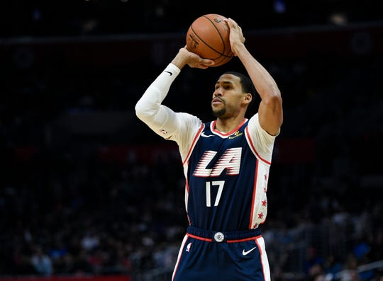 Los Angeles Clippers guard Garrett Temple attempts a shot during the second half of an NBA basketball game against the Cleveland Cavaliers in Los Angeles, Saturday, March 30, 2019. The Clippers won 132-108. (AP Photo/Kelvin Kuo)