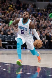 Charlotte Hornets' Shelvin Mack dribbles during the first half of an NBA basketball game against the Indiana Pacers, Monday, Feb. 11, 2019, in Indianapolis. (AP Photo/Darron Cummings)