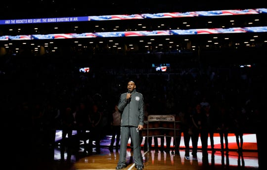 Brooklyn Nets' Jerry Stackhouse sings the national anthem before Game 1 against the Chicago Bulls in the first round of the NBA basketball playoffs at the Barclays Center Saturday, April 20, 2013 in New York.  (AP Photo/Seth Wenig