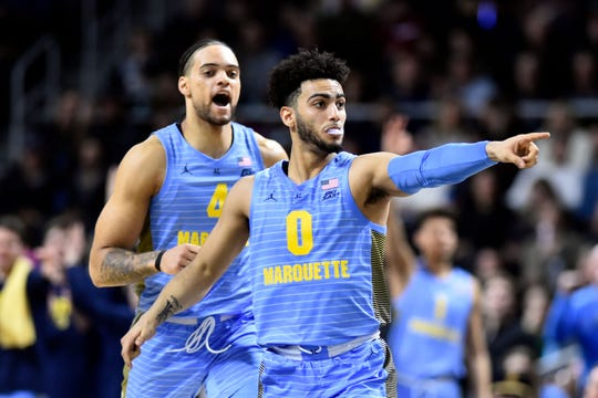 Marquette Golden Eagles guard Markus Howard (0) and forward Theo John (4) react after a score against the Providence Friars during the second half at the Dunkin Donuts Center.