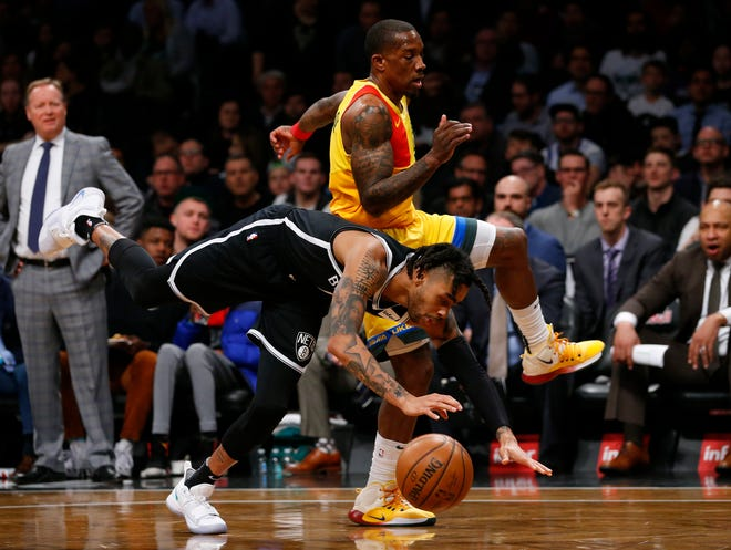 Nets guard D'Angelo Russell  is fouled by Milwaukee Bucks guard Eric Bledsoe.