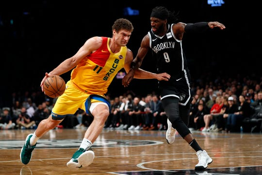 Bucks center Brook Lopez drives to the rack against Nets forward DeMarre Carroll during the second half.