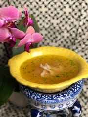 Ginger chicken soup will warm you up deliciously while doing battle with any spring colds.