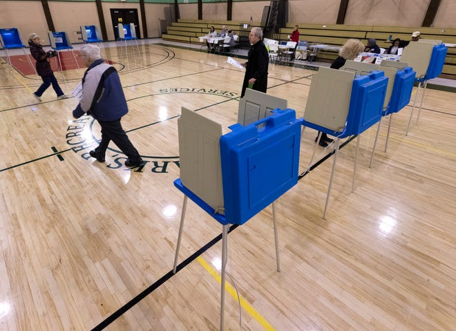 Voters cast ballots at a Racine County polling station. Candidates running for office in the Milwaukee suburbs in the spring 2020 eleciton had to file by Jan. 7.