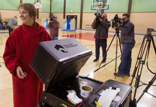 Lisa Neubauer, candidate for a seat on the Wisconsin Supreme Court,  casts her vote.