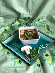 Fresh pea and mushroom consomme is a light answer to spring's chill.