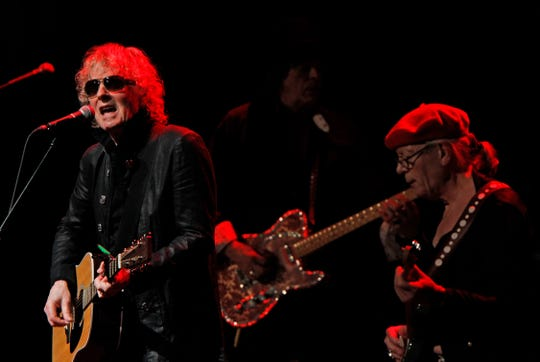 Mott, Ian Hunter, left and Ariel Bender,  right, from the Mott The Hoople, perform at the Miller High Life Theatre in Milwaukee.