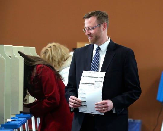Judge Brian Hagedorn holds his ballot.
