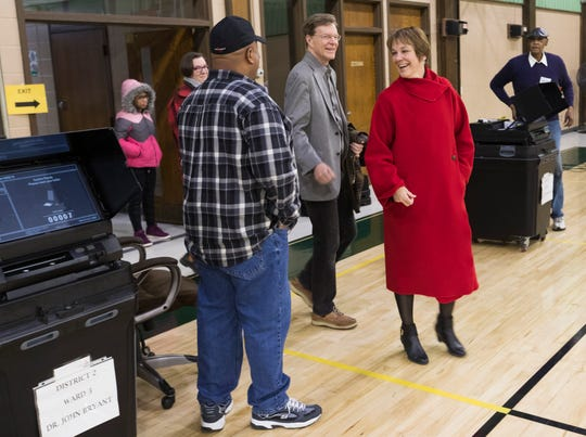 Lisa Neubauer, candidate for a seat on the Wisconsin Supreme Court, and her husband, Jeffrey, arrive to vote in Racine.