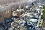 An aerial view via drone shows the destruction after a fire at the White Oaks apartment complex, in Bayside.