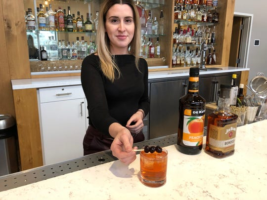Mixologist Aubrey Dodd says adding Peach Schnapps to an old-fashioned gives it a fresh taste.