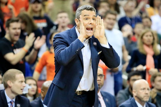 Virginia head coach Tony Bennett shouts instructions to his players during the Cavaliers' game against Purdue in the South Region final Saturday.