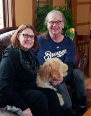 Homeowners Peggy Howe and Scott Stephan share their 1905 home with dog Lucy and parrot Gerty.