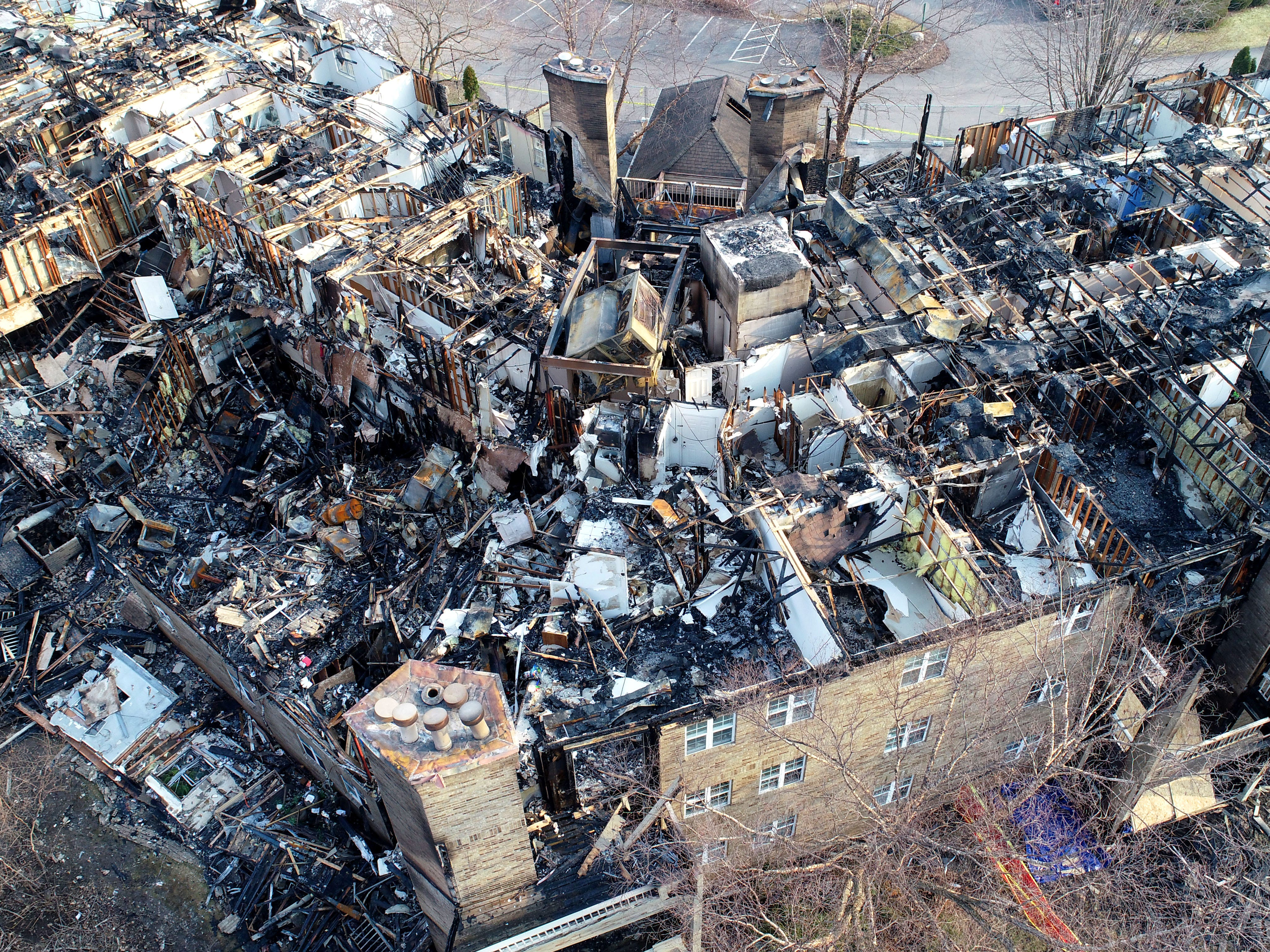 An aerial view from a drone shows the destruction after a fire.