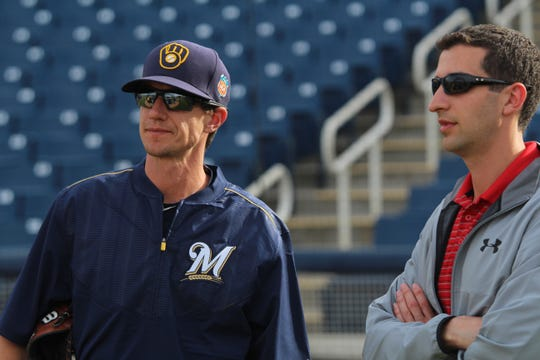Brewers General Manager David Stearns and Manager Craig Counsell talk before a spring training game, March 28, 2016.