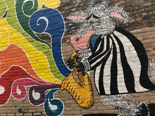 "Tim Decker's ""Jazz Goat"" is featured in Milwaukee's Black Cat Alley. Wauwatosa plans to bring murals to East Tosa in summer or fall 2019."