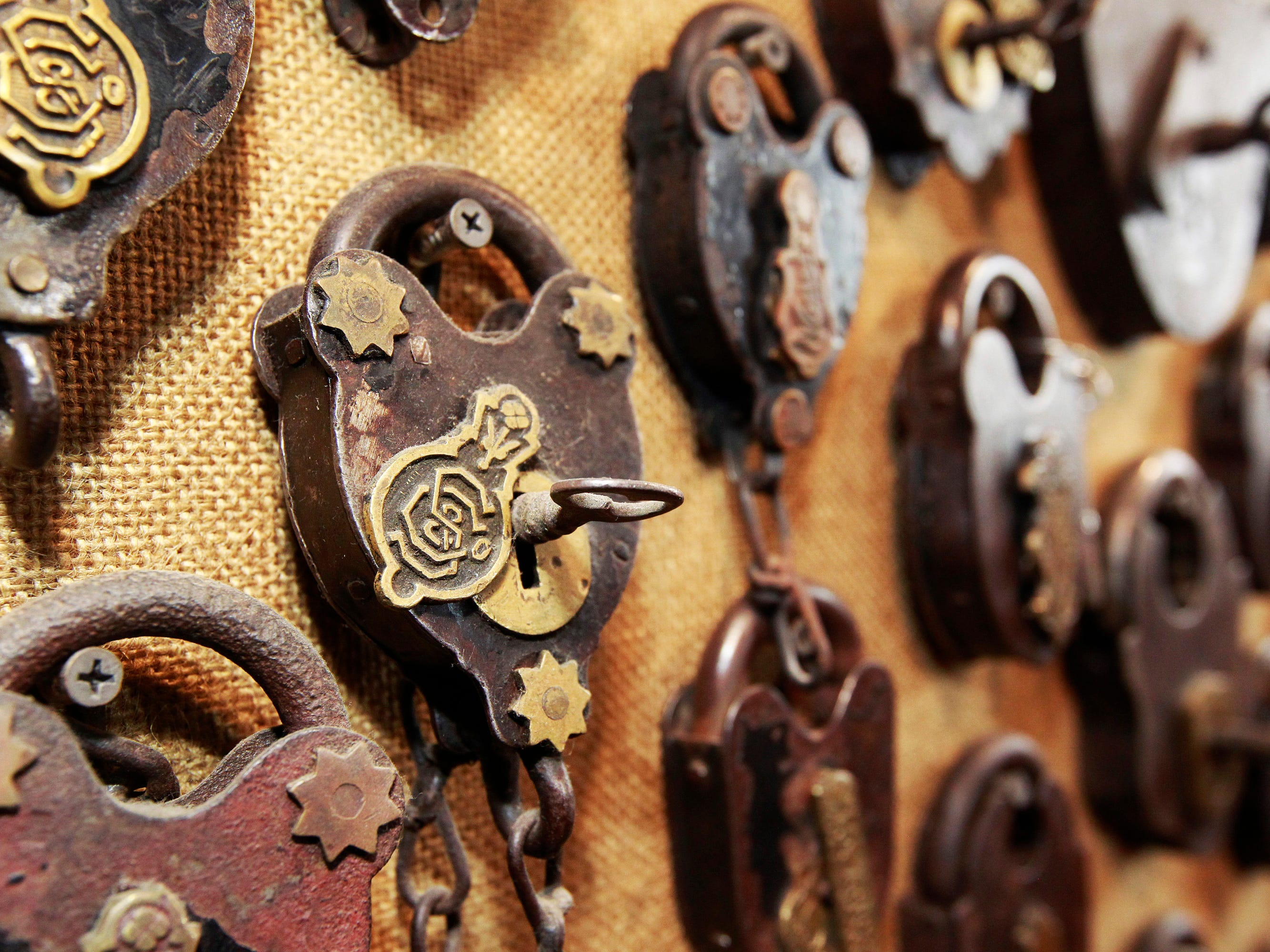 Scott Stephan displays some of his  antique locks that he's collected over the years. He's a retired master locksmith.