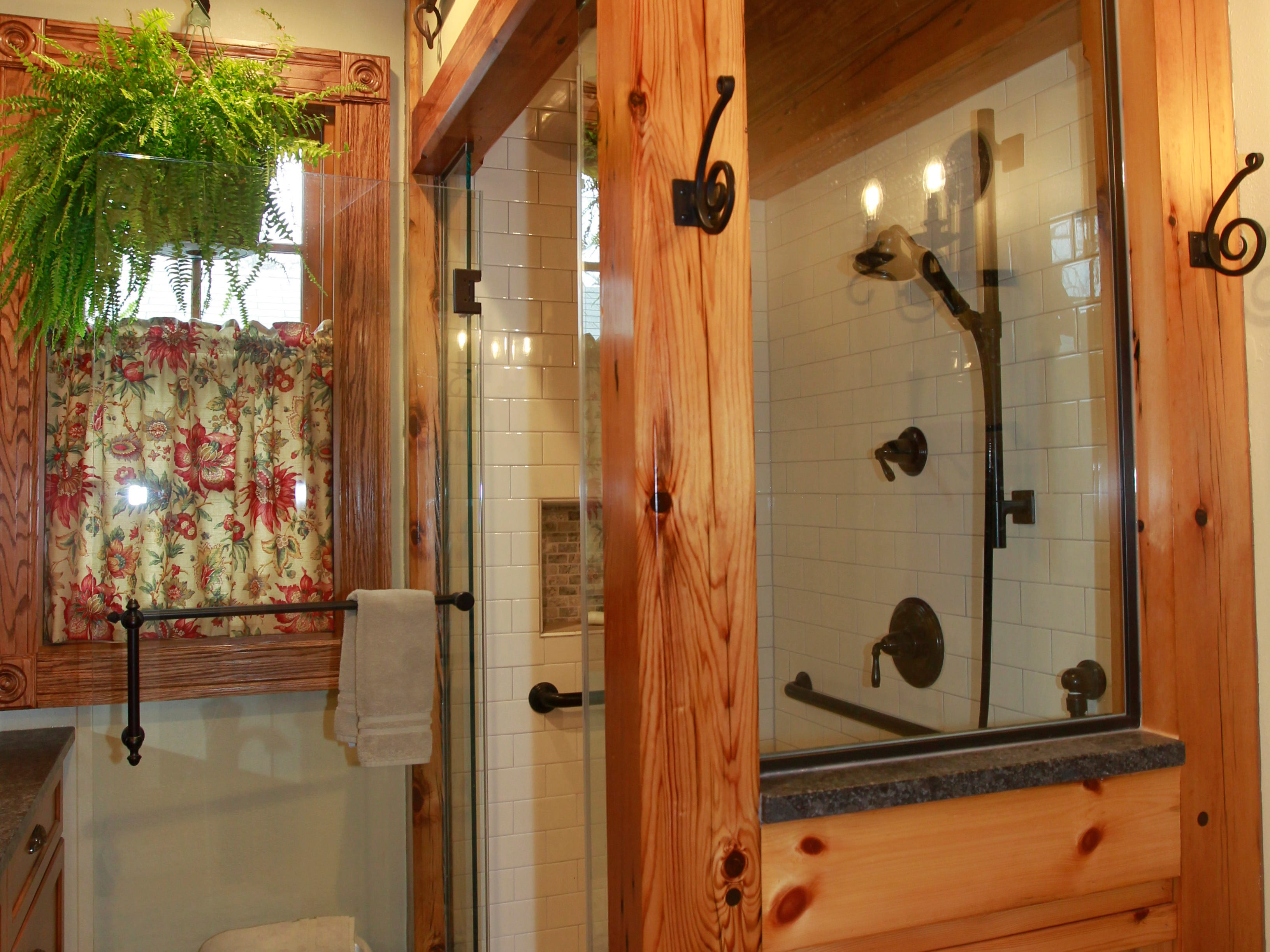 The downstairs bathroom features a pine barrel ceiling in the shower, and the floor is heated.