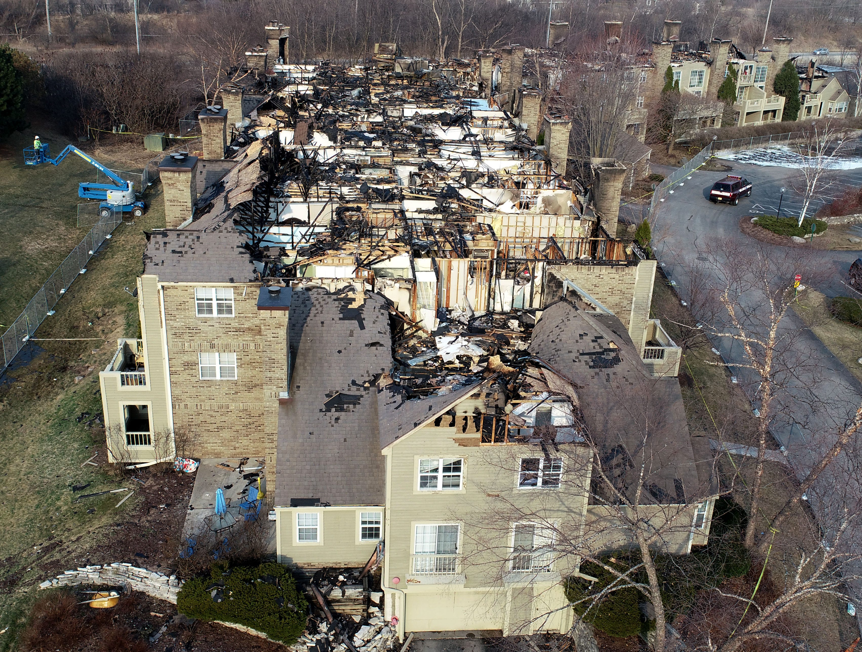 An aerial view from a drone shows the destruction after a fire at the White Oaks apartment complex in Bayside.
