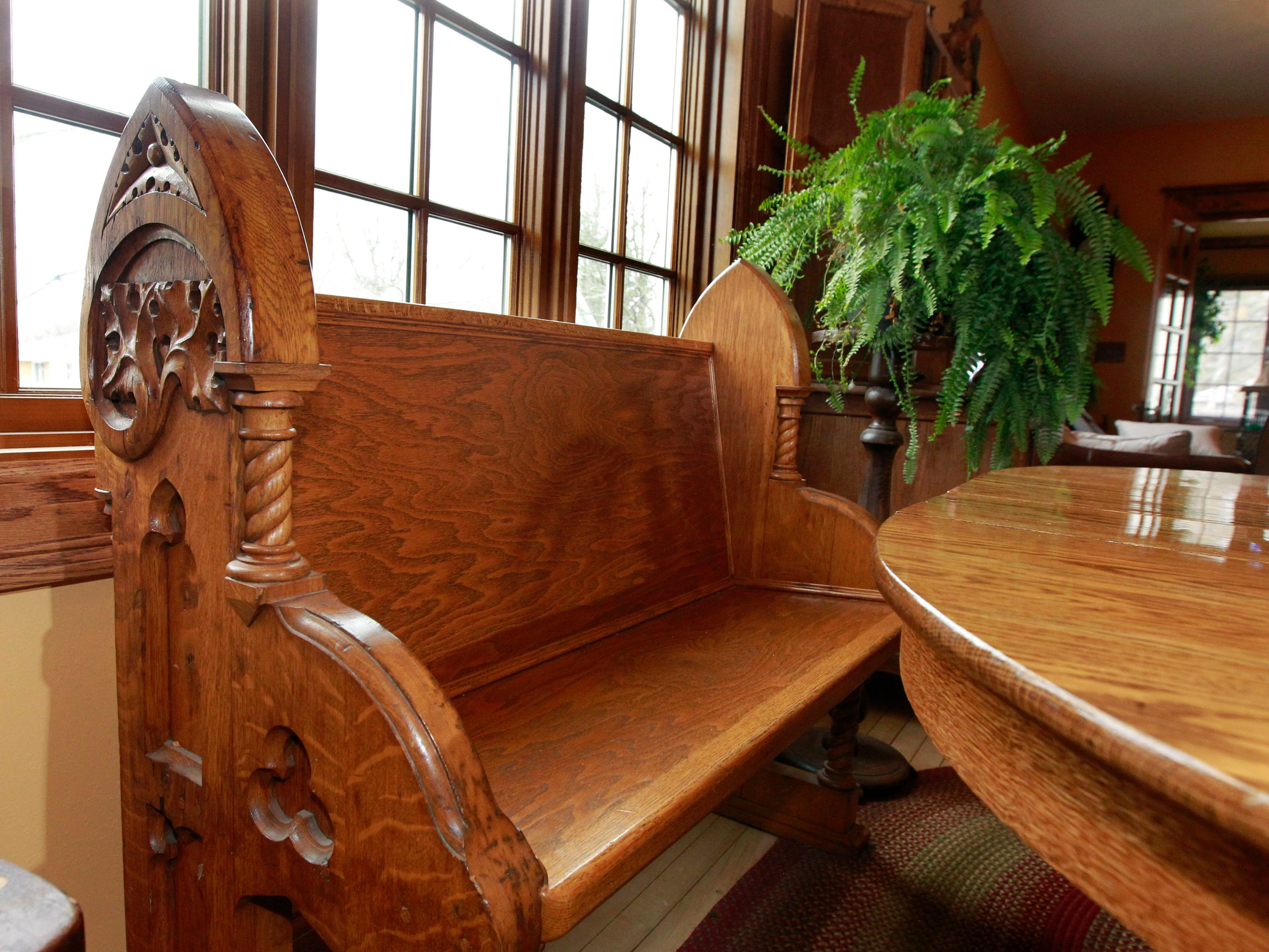 Scott Stephan found the sides from an antique church pew and added the seating to complete this bench for the dining room table.