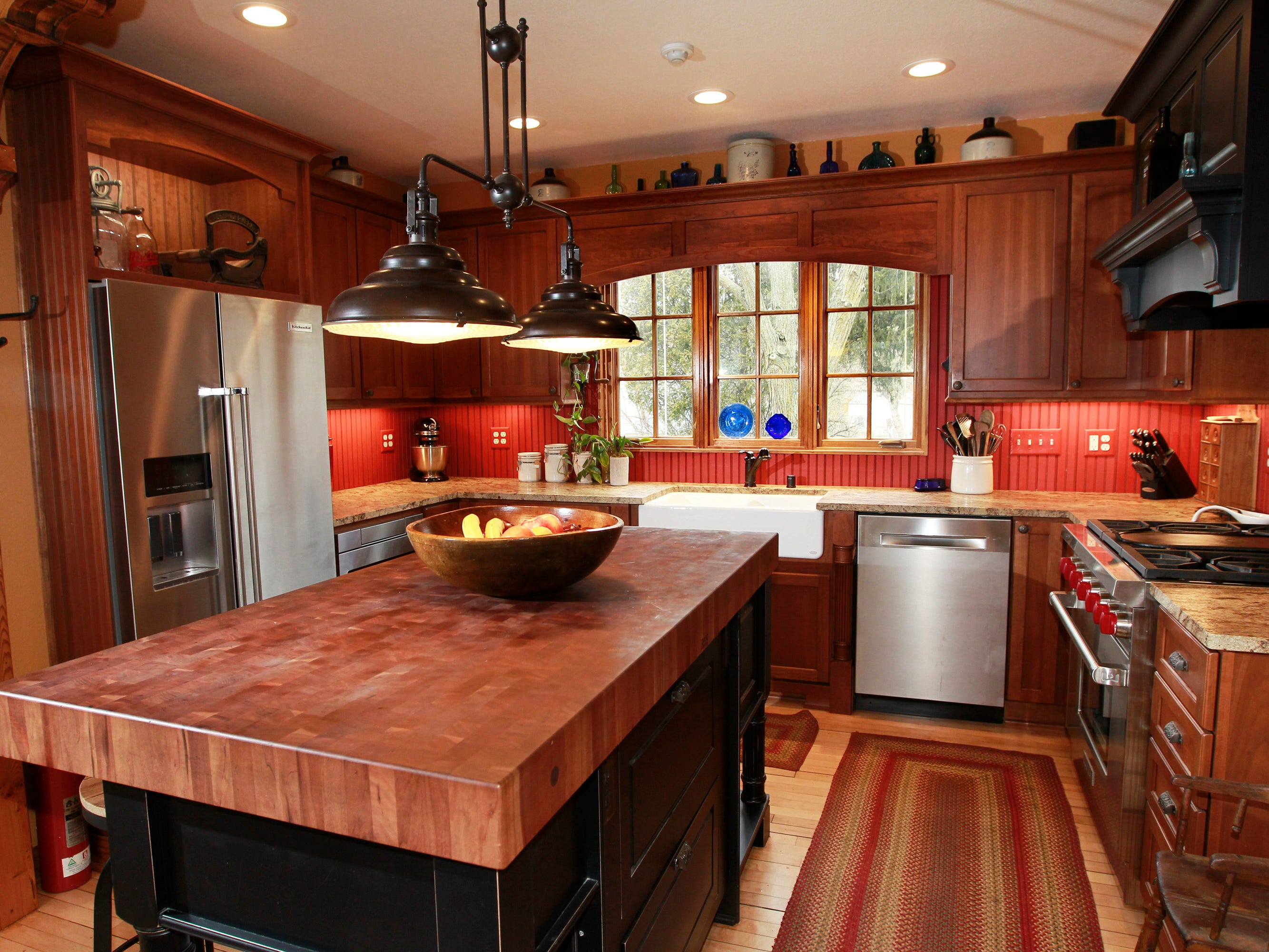 The kitchen was among the major renovations in the home. The island features an end-grain cherry wood top.