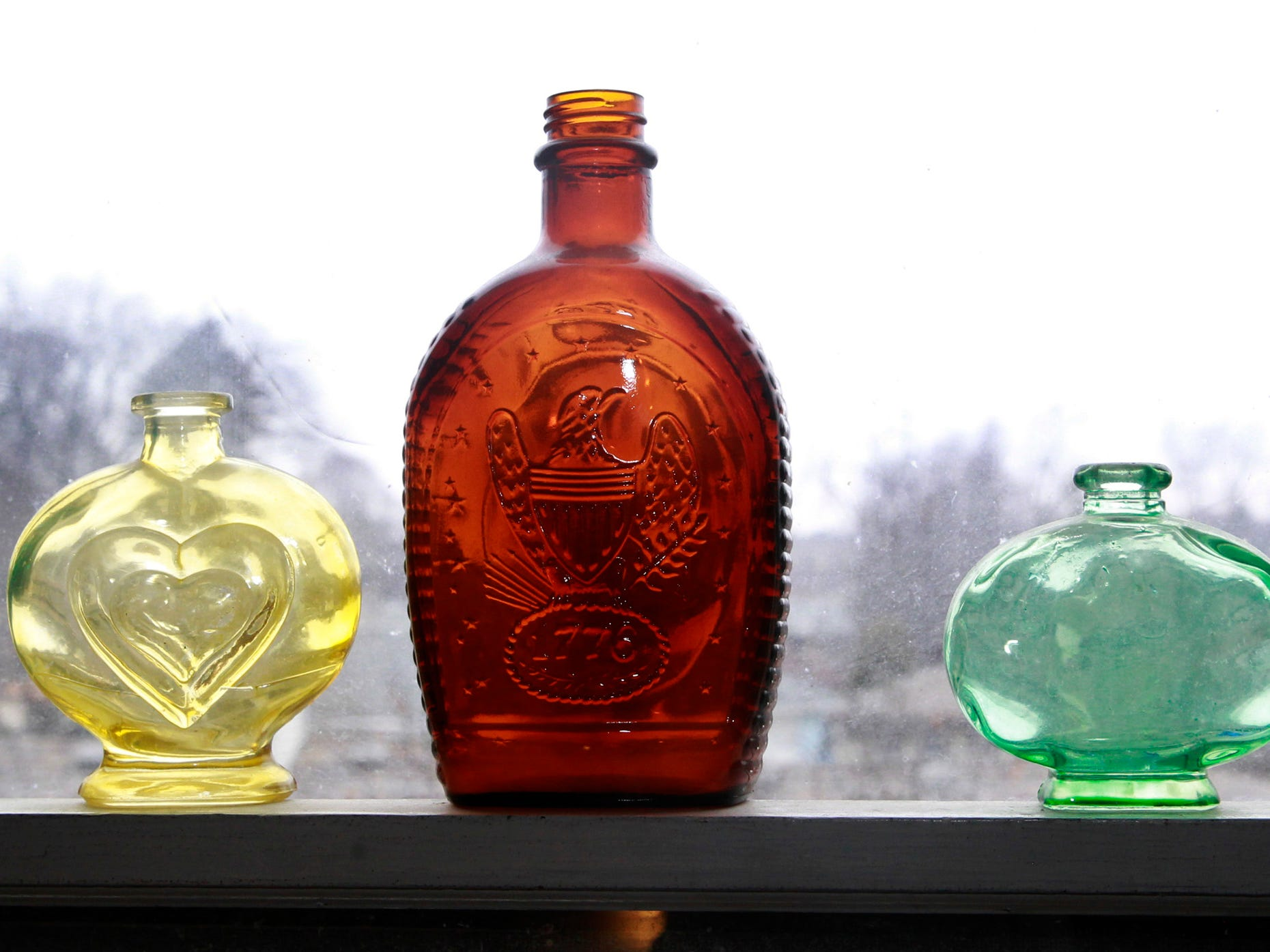 Colorful glass bottles create a pop of color and texture in Scott Stephan's home office.