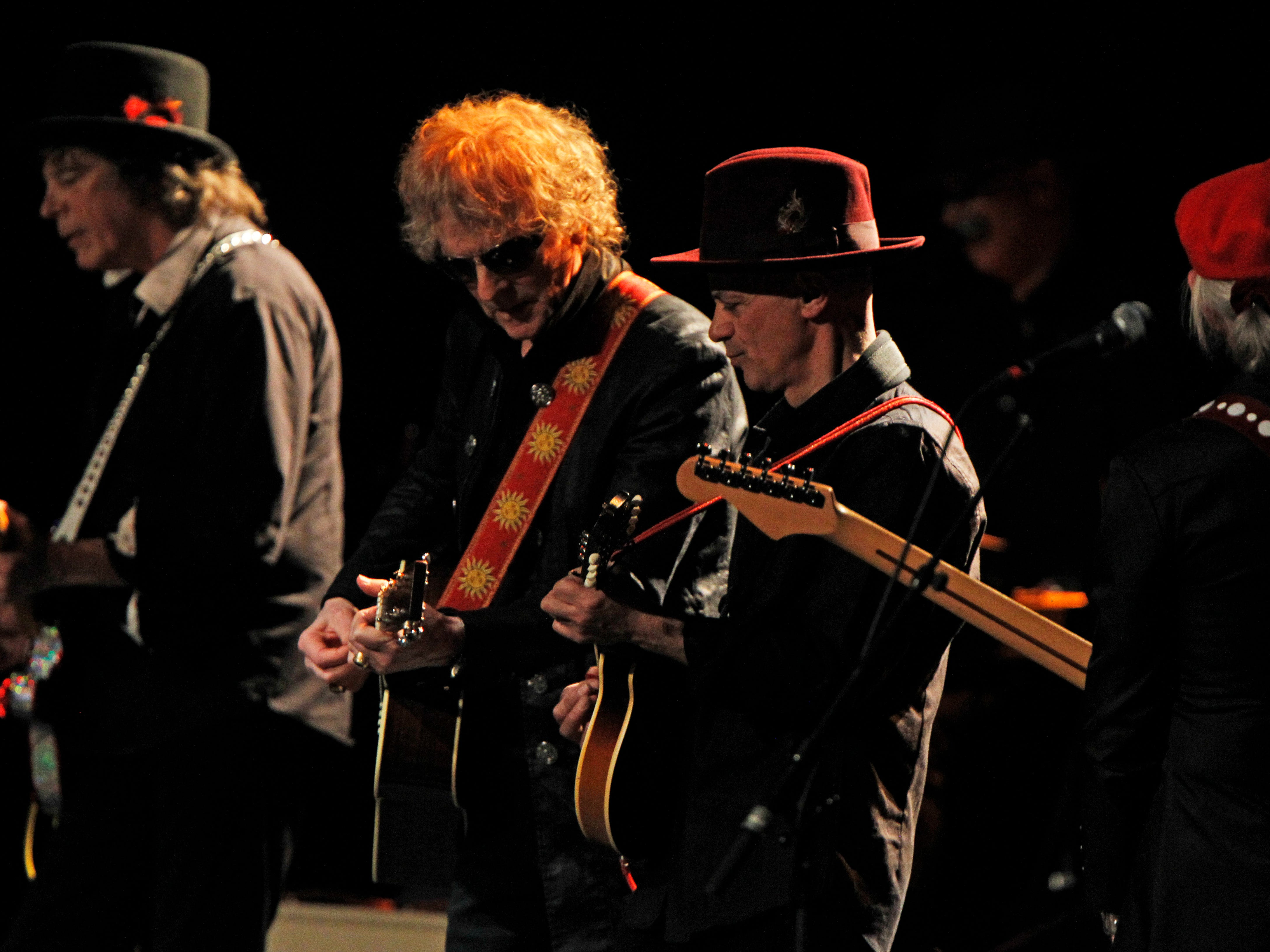 Band members from the Mott The Hoople, perform at the Miller High Life Theatre in Milwaukee.