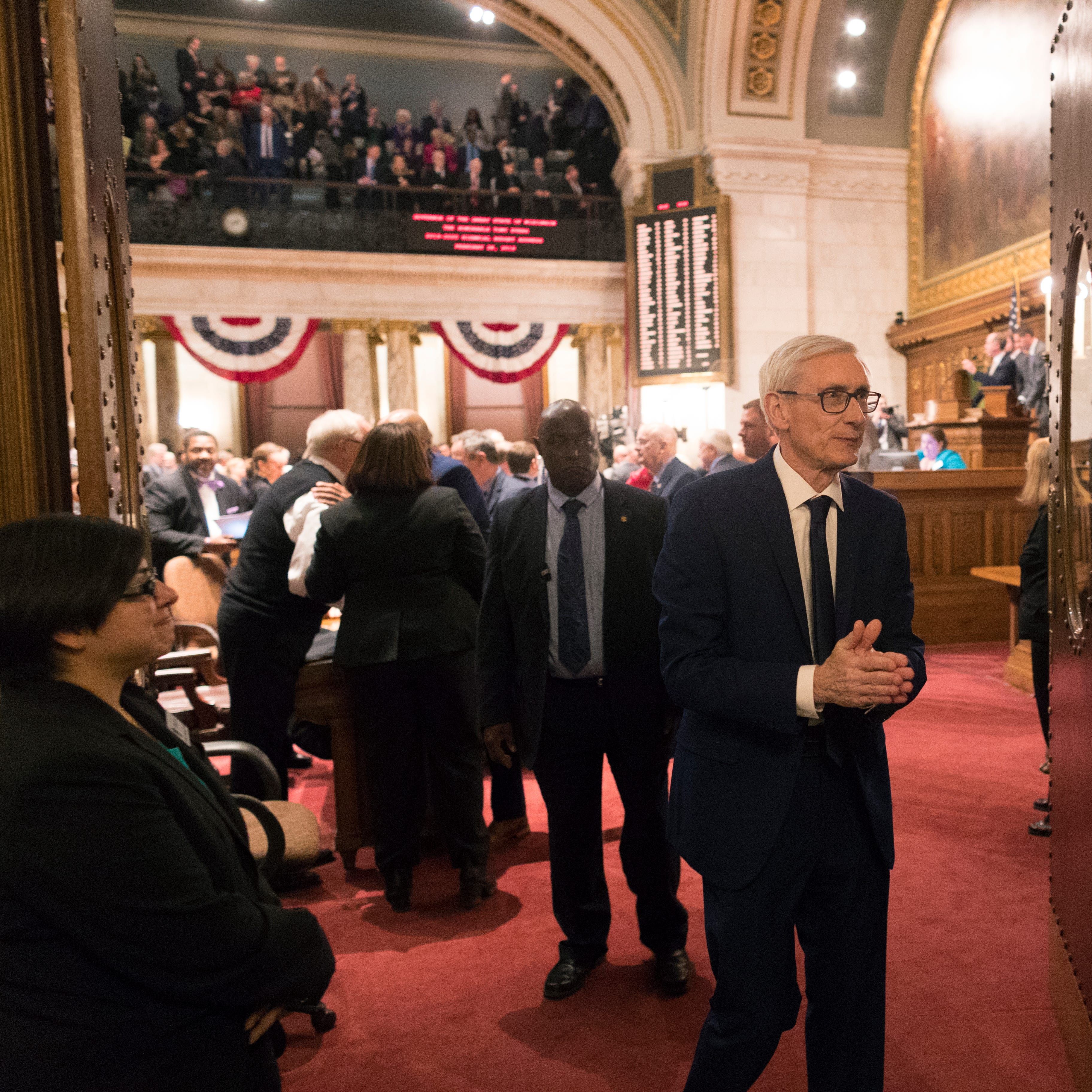 Gov. Tony Evers leaves the assembly chamber following his budget address to a joint session of the legislature  February 28 at the Capitol in Madison.