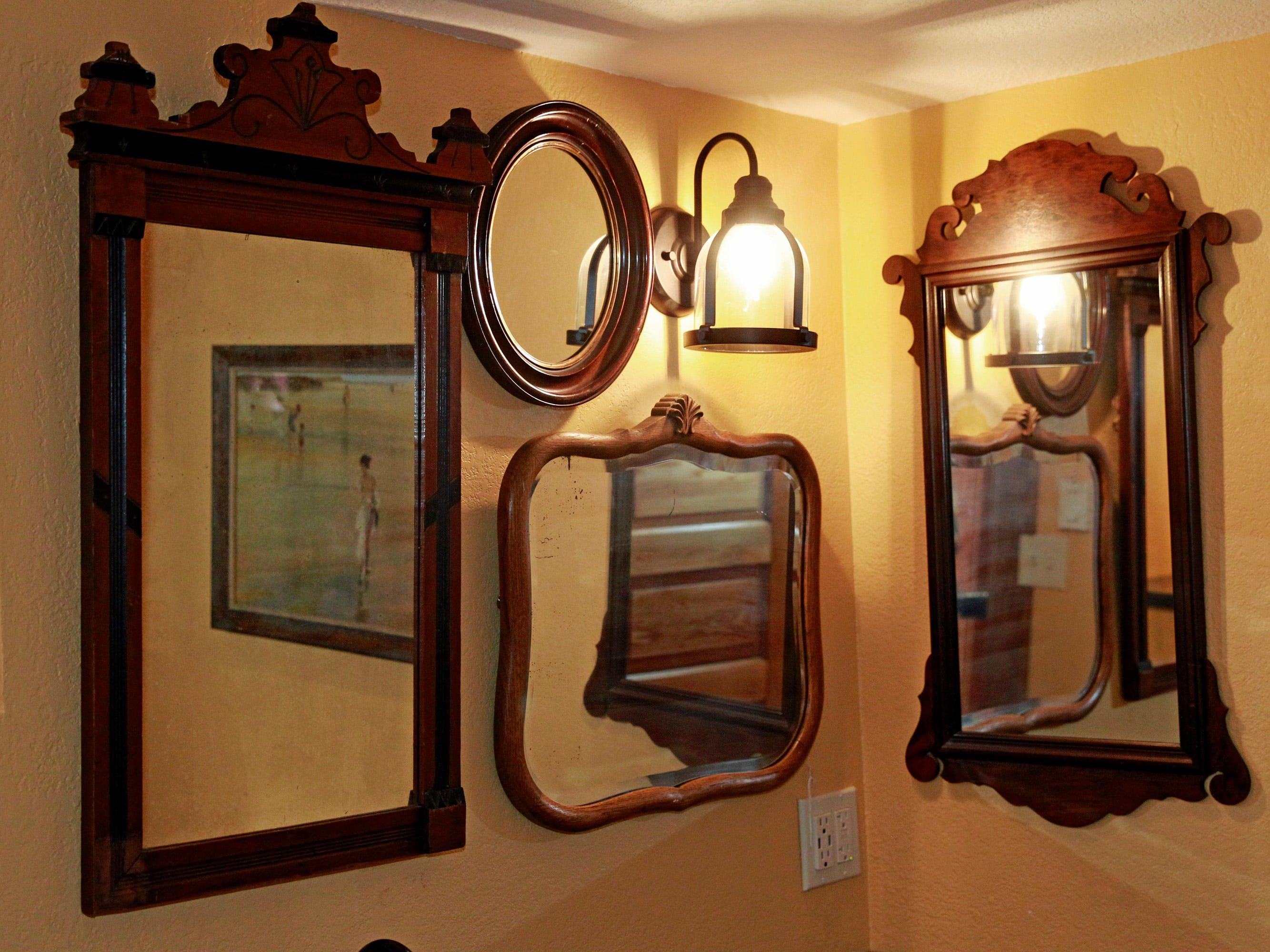An assortment of antique mirrors  add interest to the basement bathroom.