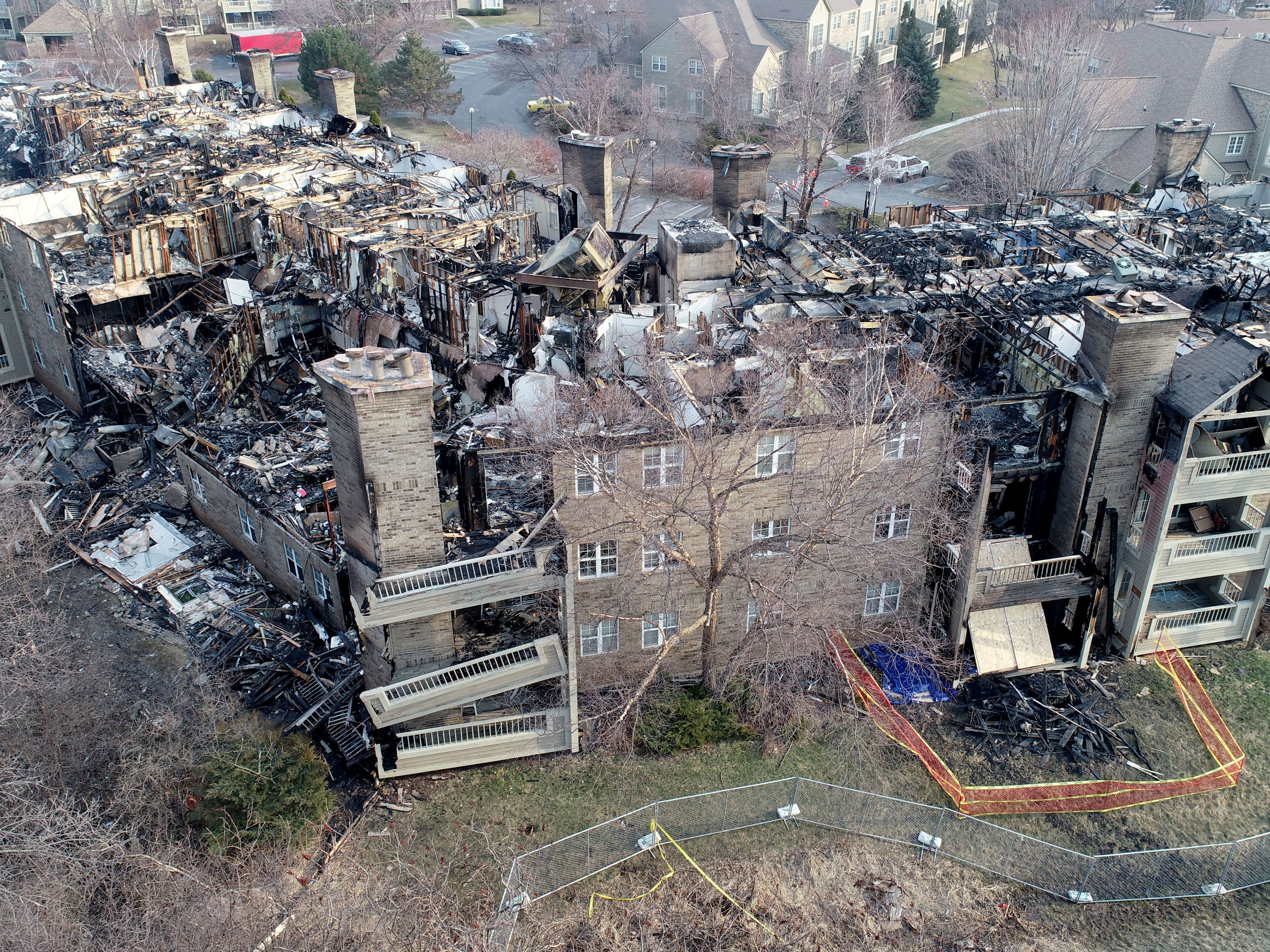 An aerial view from a drone shows the destruction after a fire at the White Oaks apartment complex, 9009 N. White Oak Lane in Tuesday, April 2, 2019, in Bayside.