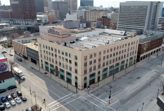 The six-story Journal Sentinel building (center), 333 W. State St., and an attached, four-story building that once housed the Milwaukee Sentinel, at 918 N. Phillips Ave., (right) are up for historic designation.