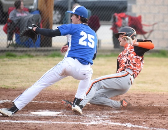 Viola's Dalton Roork slides into home safely under the tag of Koshkonong pitcher Brandon Kimbrough.