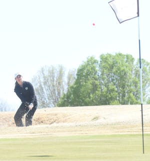 Oklahoma Baptist's Shannen Stewart hits a shot out of the sand on the ninth hole at Big Creek Golf & Country Club on Tuesday during the Henderson State Women's Spring Invitational.