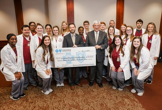 University of Louisiana Monroe President Nick J. Bruno, right, and Michael Tipton, President of the Blue Cross and Blue Shield Foundation, left, with students from the Kitty DeGree School of Nursing at a press conference April 2 where Tipton presented a check for a $96,679 grant for the Screening for Life program. Nursing and Health Sciences students and faculty will be part of the program's health screening initiatives.