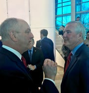 Gov. John Bel Edwards, left, and CenturyLink CEO Jeff Storey discuss the company's announcement to keep CenturyLink's headquarters in Monroe.