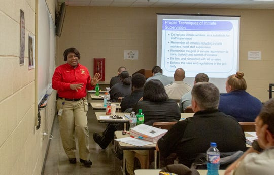 Maj. Sonja Pritchett talks to corrections officers in training about the proper way to supervise inmates.