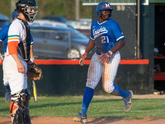 Macon East's Derrick Hooks crosses the plate against Hooper Academy on the Hooper campus in Hope Hull, Ala., on Monday April 1, 2019.