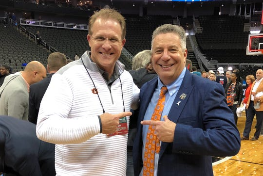 Auburn football coach Gus Malzahn (left) and men's basketball coach Bruce Pearl (right) after the Tigers' Elite Eight win over Kentucky on Sunday, March 31, 2019 in Kansas City.